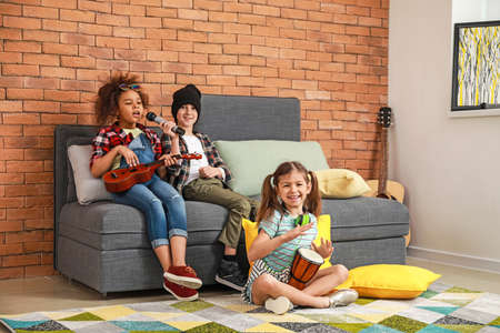 Band of little musicians at home