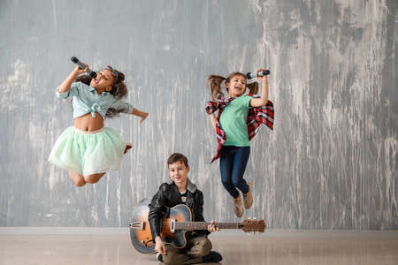 Band of little musicians against grunge wall