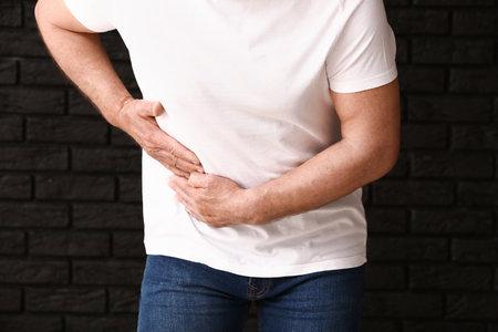 Man with urologic disease on dark background Stock Photo