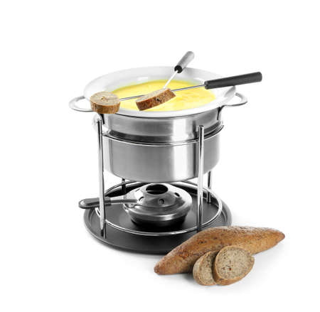 Fondue pot with melted cheese and bread on white background