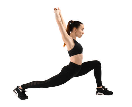Sporty woman training on white background