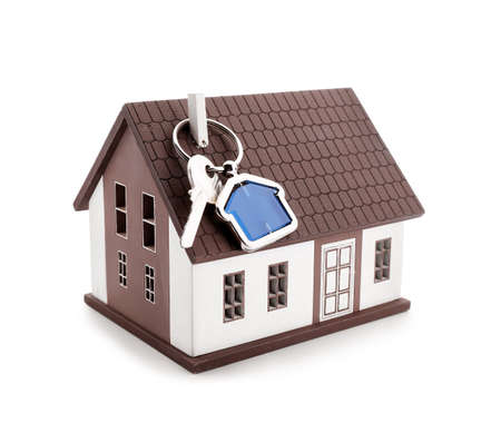 Model of house and key on white background