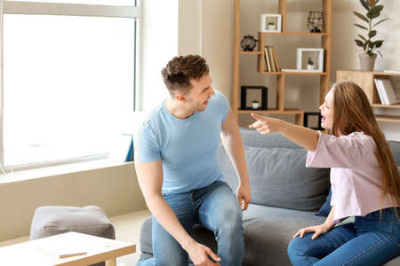 Young quarrelling couple at home