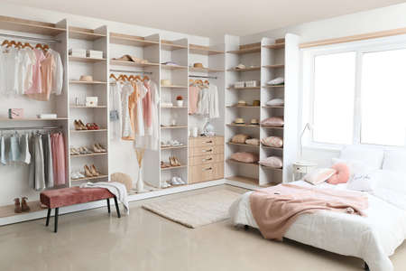 Interior of white modern bedroom with wardrobe Foto de archivo
