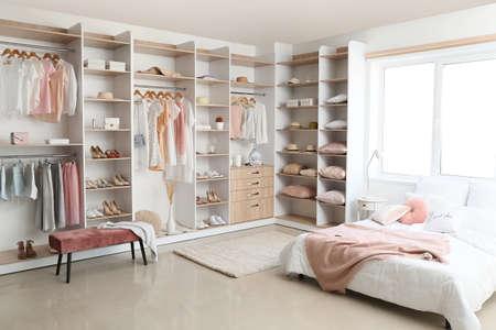 Interior of white modern bedroom with wardrobe Stock Photo