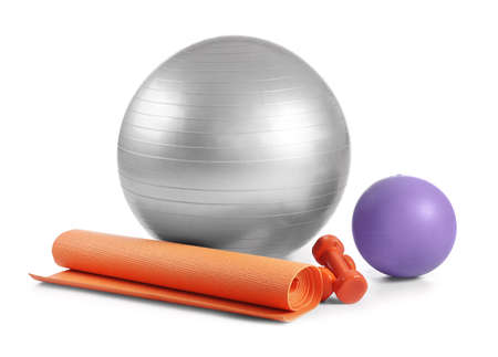 Set of sports equipment with fitness ball on white background