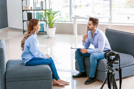 Human resources manager interviewing woman in office