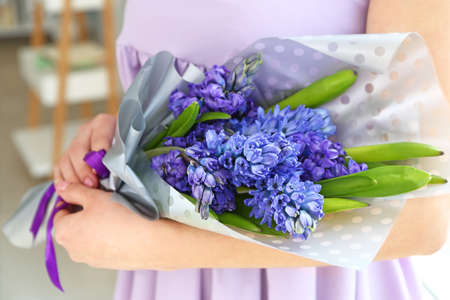 Woman with beautiful hyacinth flowers, closeup Stok Fotoğraf