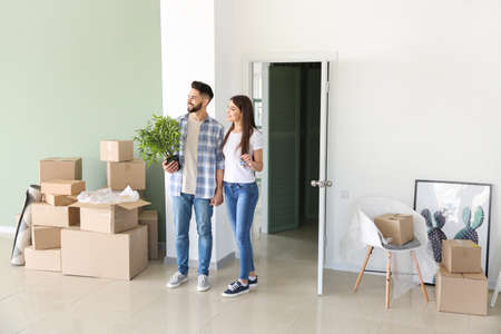 Young couple with belongings in their new house Stok Fotoğraf