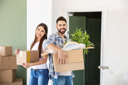 Young couple with belongings in their new house Stok Fotoğraf - 163658488