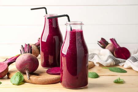 Bottles of fresh beet smoothie on table Stok Fotoğraf