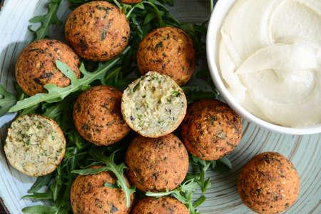 Tasty falafel balls with sauce on plate, closeup Stok Fotoğraf - 163657711