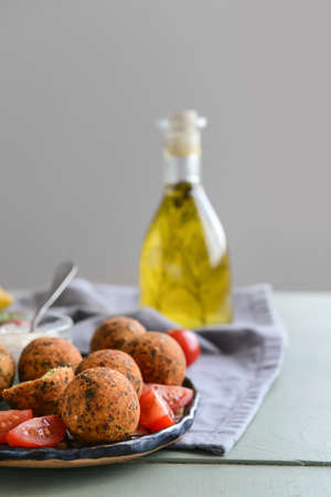 Plate with tasty falafel balls on table