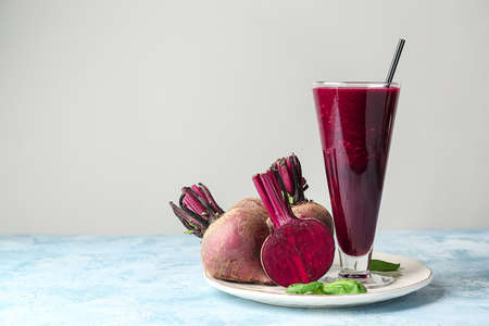 Glass of fresh beet smoothie on table