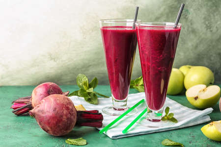 Glasses of fresh beet smoothie on table