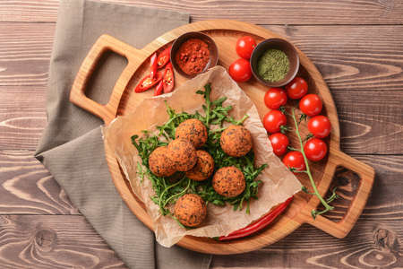 Board with tasty falafel balls and spices on wooden table Stok Fotoğraf