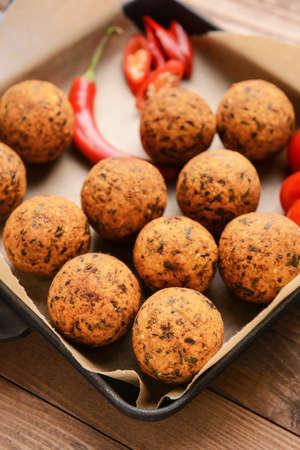 Frying pan with tasty falafel balls on wooden table, closeup Stok Fotoğraf - 163657317