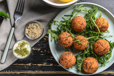 Plate with tasty falafel balls on wooden table Stok Fotoğraf