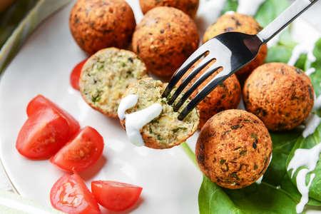 Eating of tasty falafel balls, closeup Stok Fotoğraf