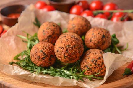 Tasty falafel balls on board, closeup