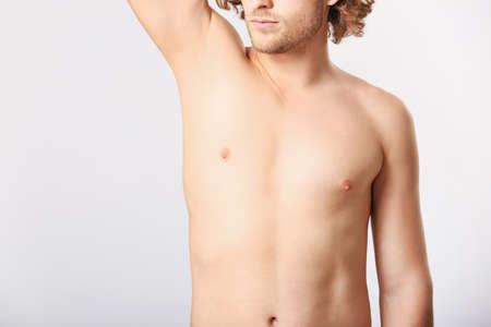 young man after epilation on light background Standard-Bild
