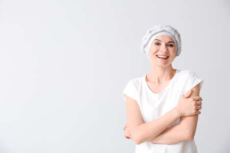 Woman after chemotherapy on light background