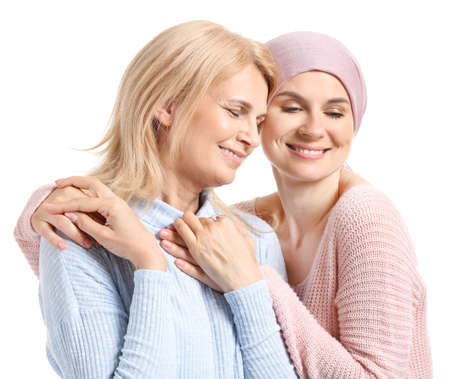 Woman after chemotherapy with her mother on white background