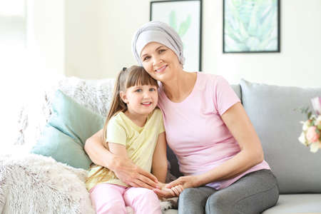 Mature woman after chemotherapy with her granddaughter at home
