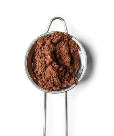 Sieve with cocoa powder on white background