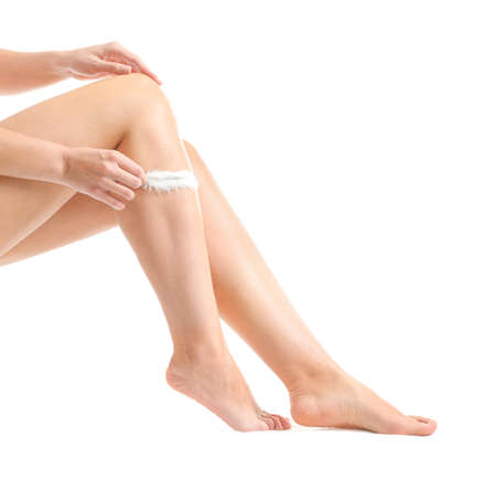 Legs of beautiful young woman after depilation on white background