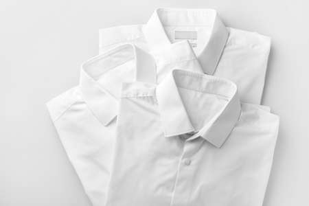 Shirts after dry-cleaning on light background Foto de archivo