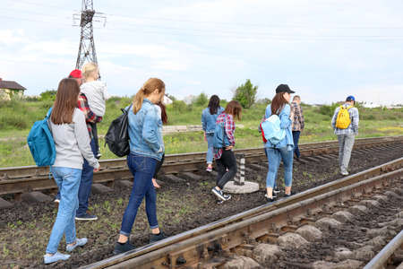 Group of illegal migrants walking along railway tracks 版權商用圖片