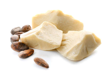 Pieces of cocoa butter on white background Banque d'images