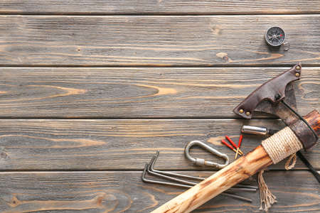 Set of items for camping on wooden background Standard-Bild