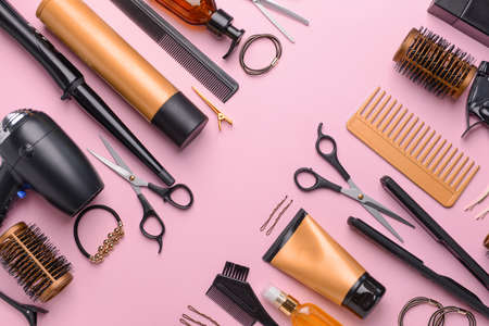 Set of hairdresser tools and accessories on color background