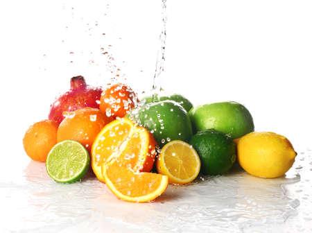 Ripe fresh fruits with water splash on white background