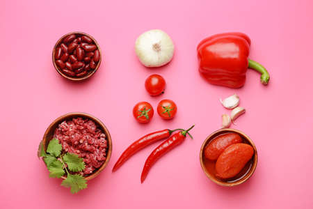 Ingredients for chili con carne on color background