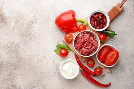 Ingredients for chili con carne on gray background