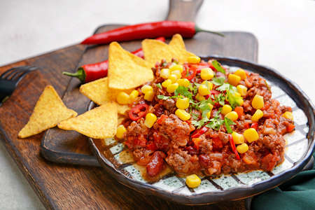 Tasty chili con carne on plate