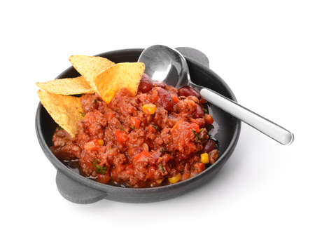 Frying pan with tasty chili con carne on white background
