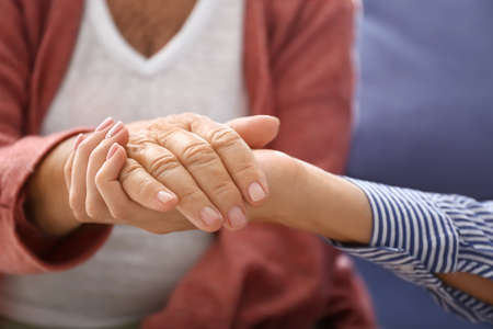 Young daughter supporting elderly mother at home, closeup Banque d'images - 164994477