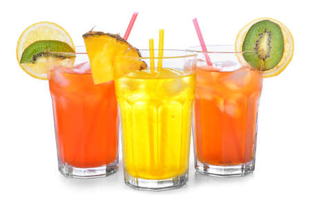 Different cocktails in glasses on white background