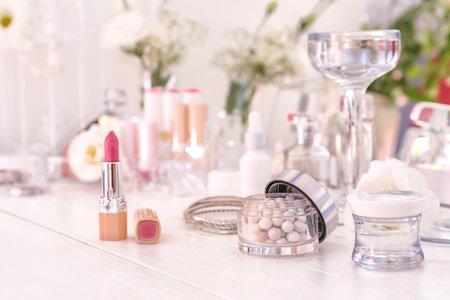 Makeup cosmetics on white dressing table Archivio Fotografico