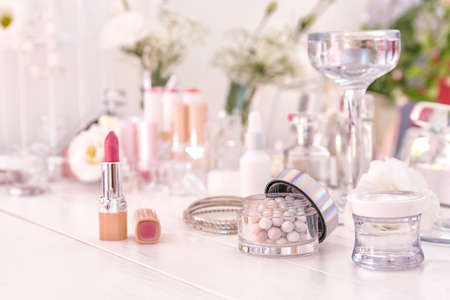 Makeup cosmetics on white dressing table Stock Photo