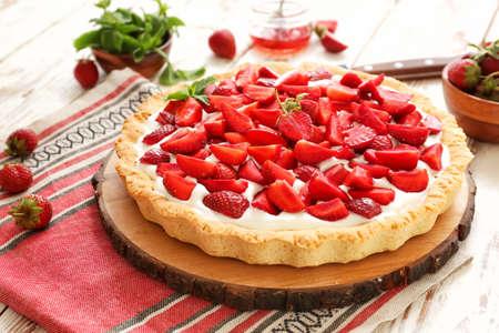 Tasty strawberry cake on white wooden table Stock Photo