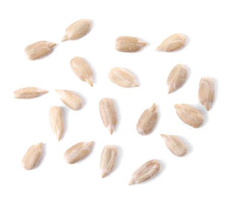 Peeled sunflower seeds on white background Imagens
