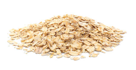 Heap of raw oatmeal on white background Banque d'images