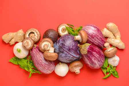 Assortment of fresh vegetables on color background