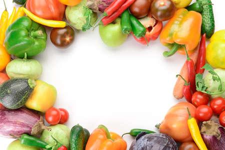 Frame made of fresh vegetables on white background