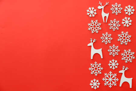 Christmas decor in shape of snowflakes and deer on color background